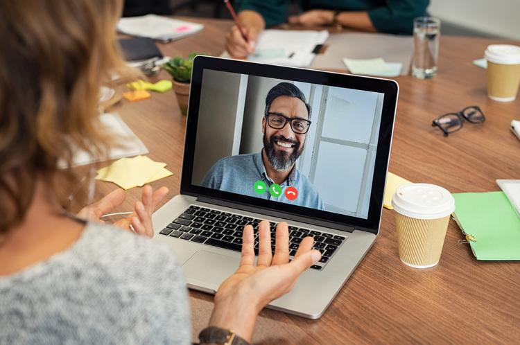 Woman video calling colleague