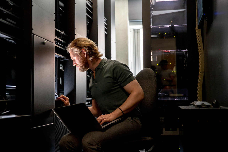 data engineer examining a data server
